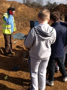 Recording info from experts on school trips (that's an Anglo Saxon skeleton down there!)